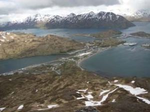 Dutch Harbor/Unalaska is located on an island in the Aleutian Islands of western Alaska.  It is a major fishing port, and its human history stretches back more than 9,000 years.