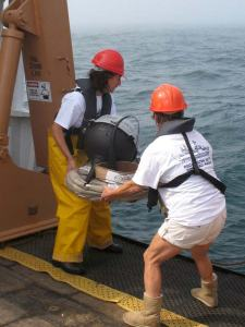 Teachers Amy Pearson and Kim Pratt deploy a drifter buoy