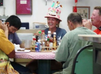 TAS Braun enjoys her birthday dinner with the crew.