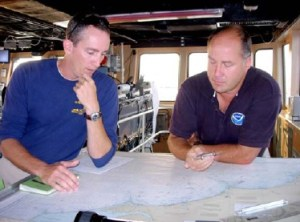 On the Bridge, XO LT. Stephen Meador and CO CDR. James Verlaque plot the course for NOAA ship NANCY FOSTER.