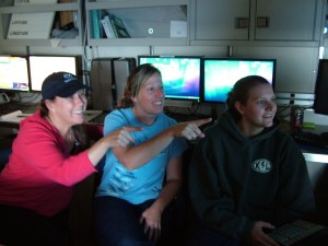 Stacey Harter, LT JG Heather Moe and I watching the big monitor and calling out the fish that we are seeing to be recorded.