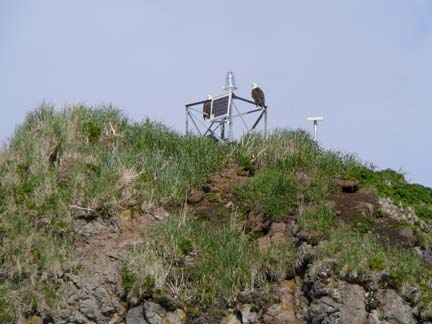 Two bald eagles sit on the top of the navigational light on Andronica Island.  A beautiful scene as we took a break from our work!