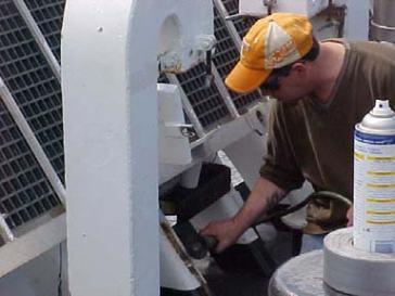 Crew member GVA Milton Ellison doing  ship maintenance on the RAINIER.