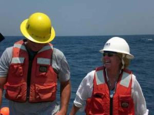 Steve Matthews, NOAA scientist, and Nancy McClintock, NOAA Teacher at Sea, celebrate the success of another ROV deployment.