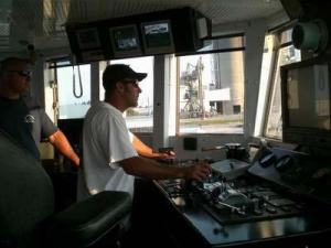 Mike Nicholas, FREEDOM STAR 2nd Mate, enters the lock at Port Canaveral as Allan Gravina, FREEDOMS STAR Able Bodied Seaman, looks on.