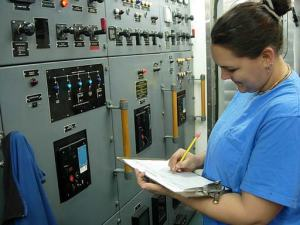 Assistant Engineer Kelly Baughman, checking gages in Central Engine Room Control.