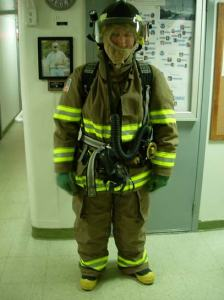 Ordinary Seamen (OS) Megan Guberski fully suited in her turnout gear onboard NOAA ship RAINIER.