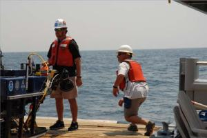 Andy stands guard as Mark hurries into position in preparation to deploy the ROV in the South  Carolina Option aboard the FREEDOM STAR.