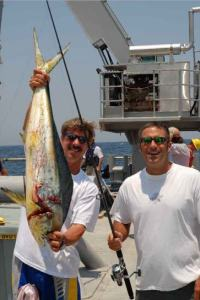 Wayne Stewart, crane operator, and Mike Nicholas, second mate, show off a dolphin that I spotted.