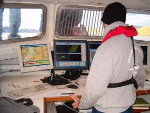 Ensign Stevenson collects multi-beam bathymetric data from the launch