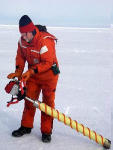 Dr. Ned Cokelet drills an ice core using a gas powered engine. It allows the scientists to take samples quickly and efficiently.