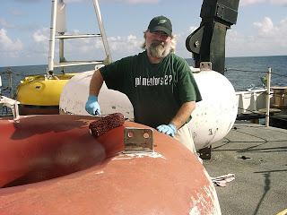 Rick painting the buoy
