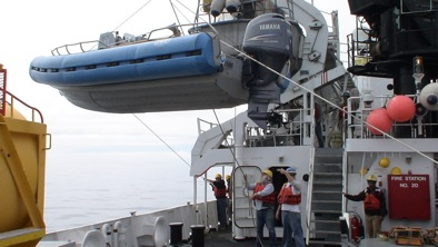 Moving a launch requires careful communication as well as good rigging skills.  A constant vigilance is also mandatory.