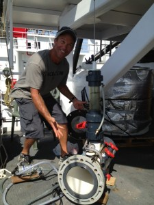 Kevin Lewand of the Monterey Bay Aquarium constructs a hyperbaric chamber for marine life on board the Sette.