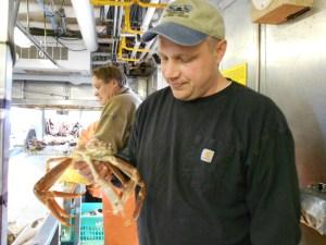 Kresimir Williams holding a crab