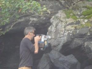 Senior Survey Tech Barry Jackson drill into bedrock, preparing to install a benchmark.