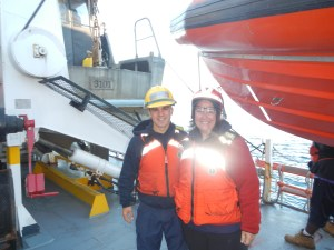 Teacher at Sea with ENS Casey Marwine (yes, those reflectors do work on the life jackets!)