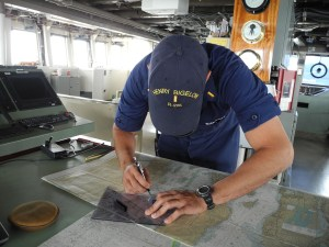 Ensign Estrada plotting the ship's course