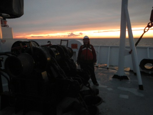 That's me, getting ready for us to drop anchor in Gardiners Bay at sunset