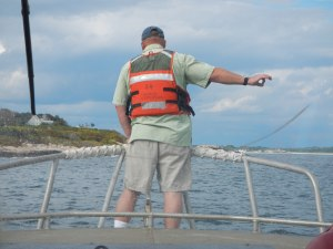 One of the survey techs helping the coxswain navigate these rocky waters