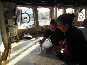 ENS Deveraux showing me how she is plotting a course to our research area.