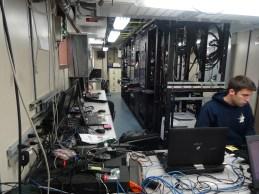 Acoustics technician Dan Palance manages multiple computers