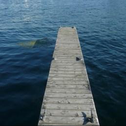 A wooden dock in Alexandria Bay, NY