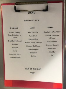 A clipboard shows the daily menu for breakfast, lunch, and dinner.