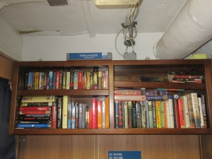 Shelves of books in the ship's library.