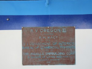 A metal plaque describing the design and shipbuilding history of the Oregon II.