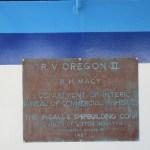 A metal plaque describing the design and shipbuilding history of the Oregon II.