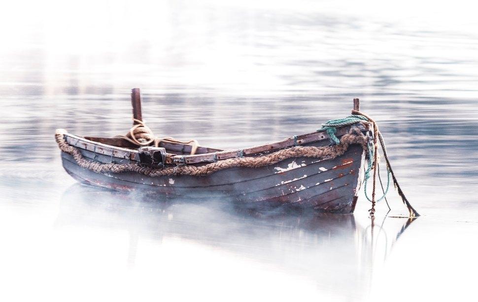 zoltan-tasi-Fog Boat -unsplash