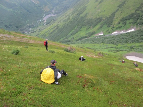 Sledding Down from Eagle Glacier on Grass
