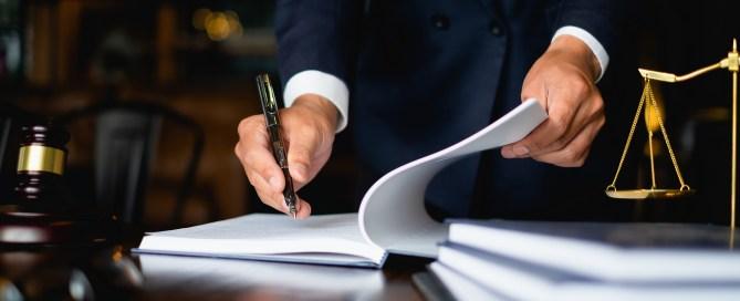 legislator writing in notebook