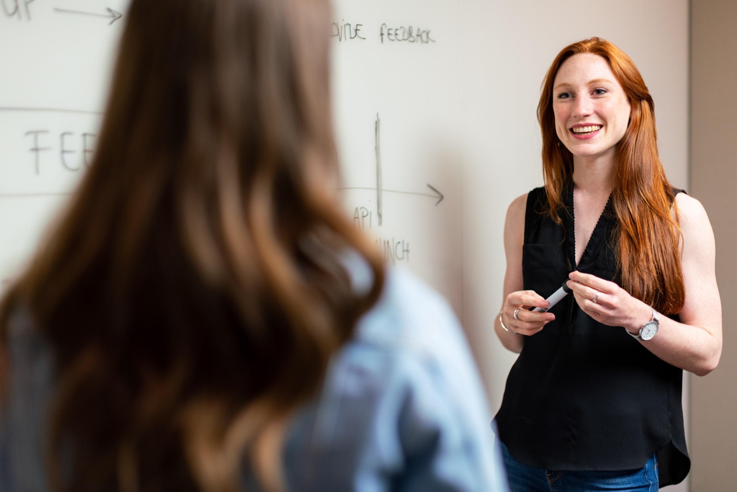 two women talking in classroom