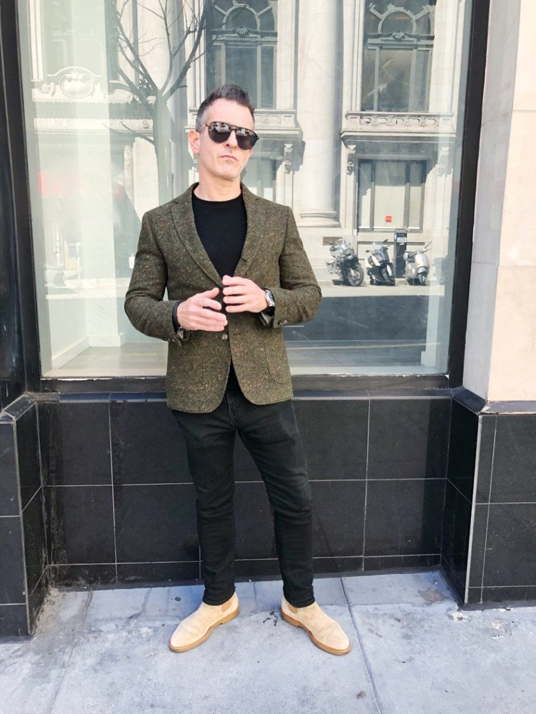 "We stopped Jeremy Ogur because his outfit told us that he was doing something important. His personal style draws inspiration from his New York roots and SF residence. ""[It's] a mix of rock 'n' roll and streetwear."" Blazer: Brooklyn Tailors; Sweater: Armani; Boots: Common Project; Jeans: Levi's"