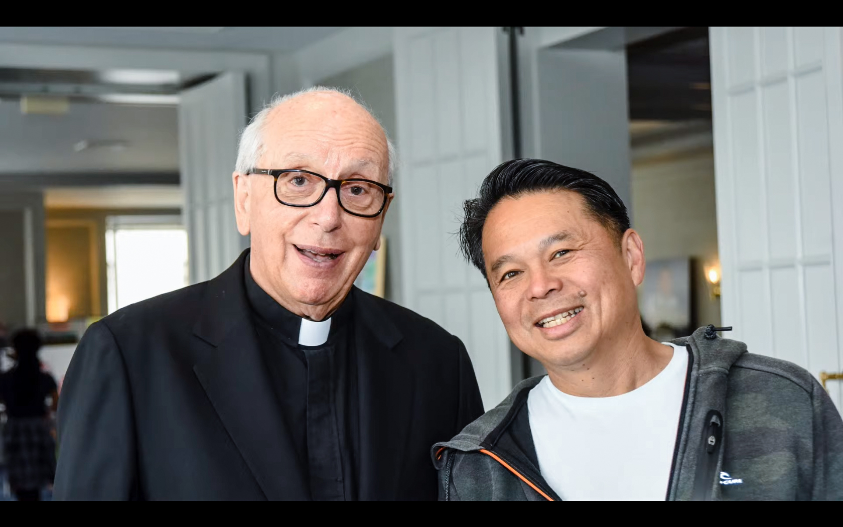MDA co-founder Fr. Charles Gagan, S.J. (left) and chef Charles Phan