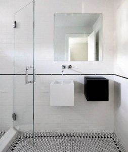 Modern and clean, this bathroom leans into geometry with Waterwork tiles, Hans Grohe Plumbing and contrasting Alape sinks.