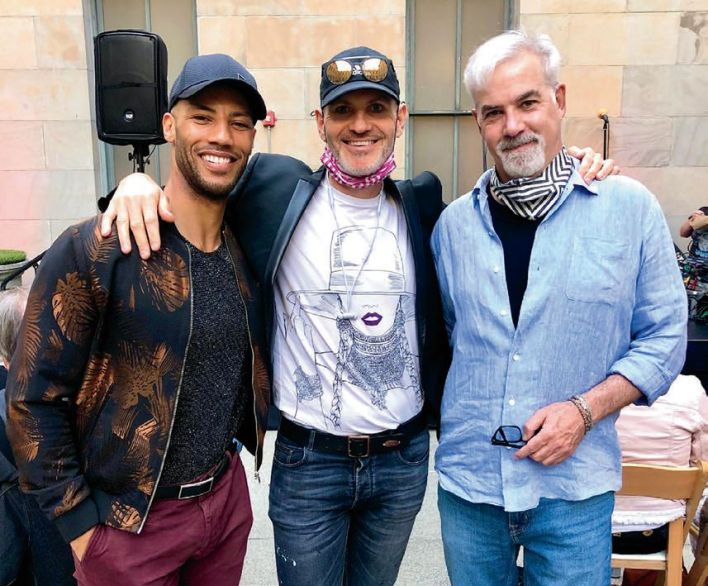 Dr. Ansu Hull joins his husband, Matthew Clark Davison, and Matthew DeCoster for in-person camaraderie at Porchlight's storytelling gathering.