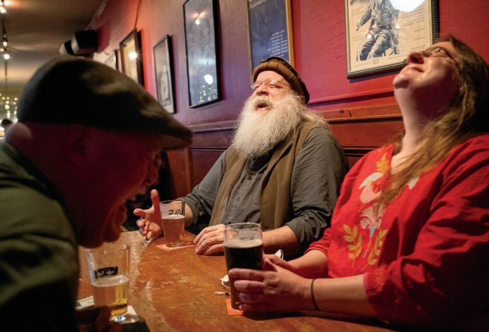 Musicians Bill Dennehy, Jack Gilder and Autumn Rhodes (pictured left to right) share a laugh while waiting for the return of live music to the Plough and Stars, where they regularly play in traditional music seisiúns.