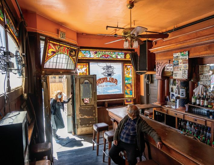 The quiet of Myron Mu's empty bar, the Saloon, is broken by a friendly hello from Janet Clyde, co-owner of Vesuvio Cafe, another venerable North Beach establishment.