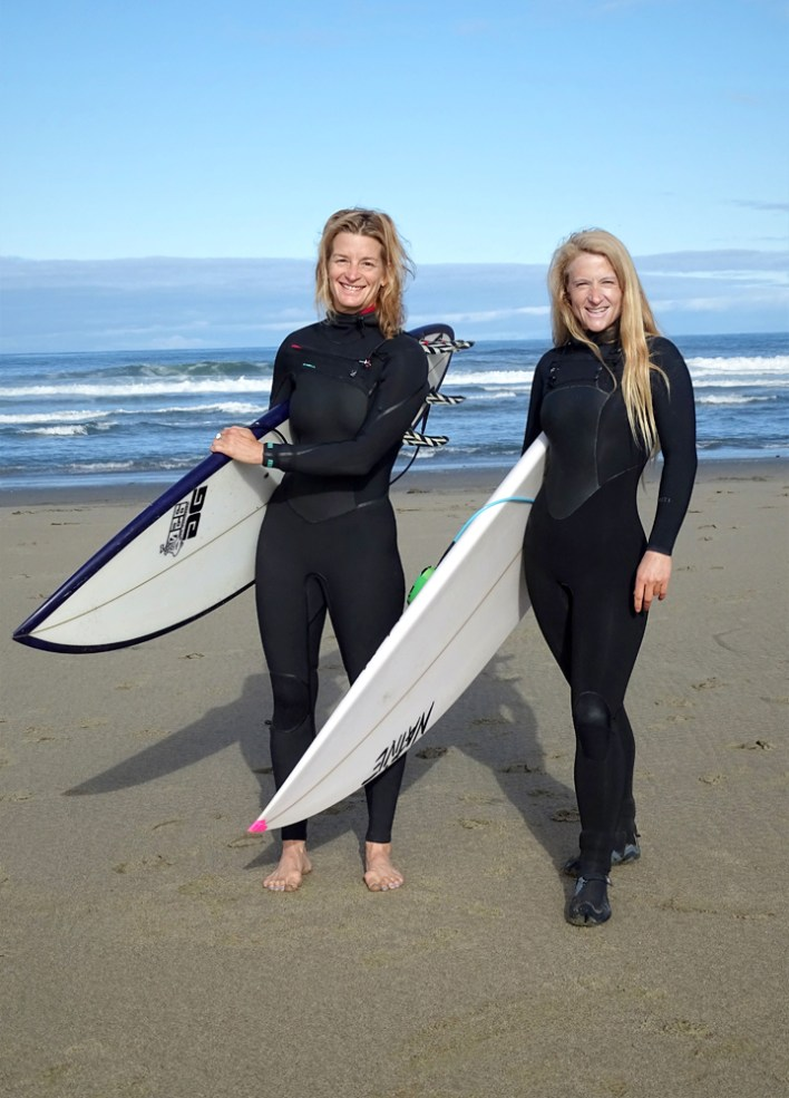 Anna Wankel (left) and Eleanor Pries get ready for a surf session at Ocean Beach.