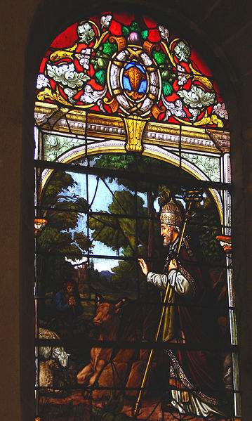 Stained glass window of Pope St. Cornelius protecting the cattle from the diseases at Saint Cornely Church, in Brittany.