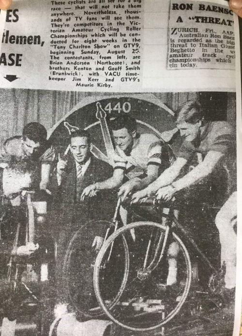 Maurie Kirby compares the Tony Charlton Show (GTV9) with competitors in the Victorian Amateur Cycling Roller Championships. From the left, Brian Anderson (Northcote) and brothers Kenton and Geoff Smith (Brunswick) with Victorian Amateur Cycling Union timekeeper Jim Kerr