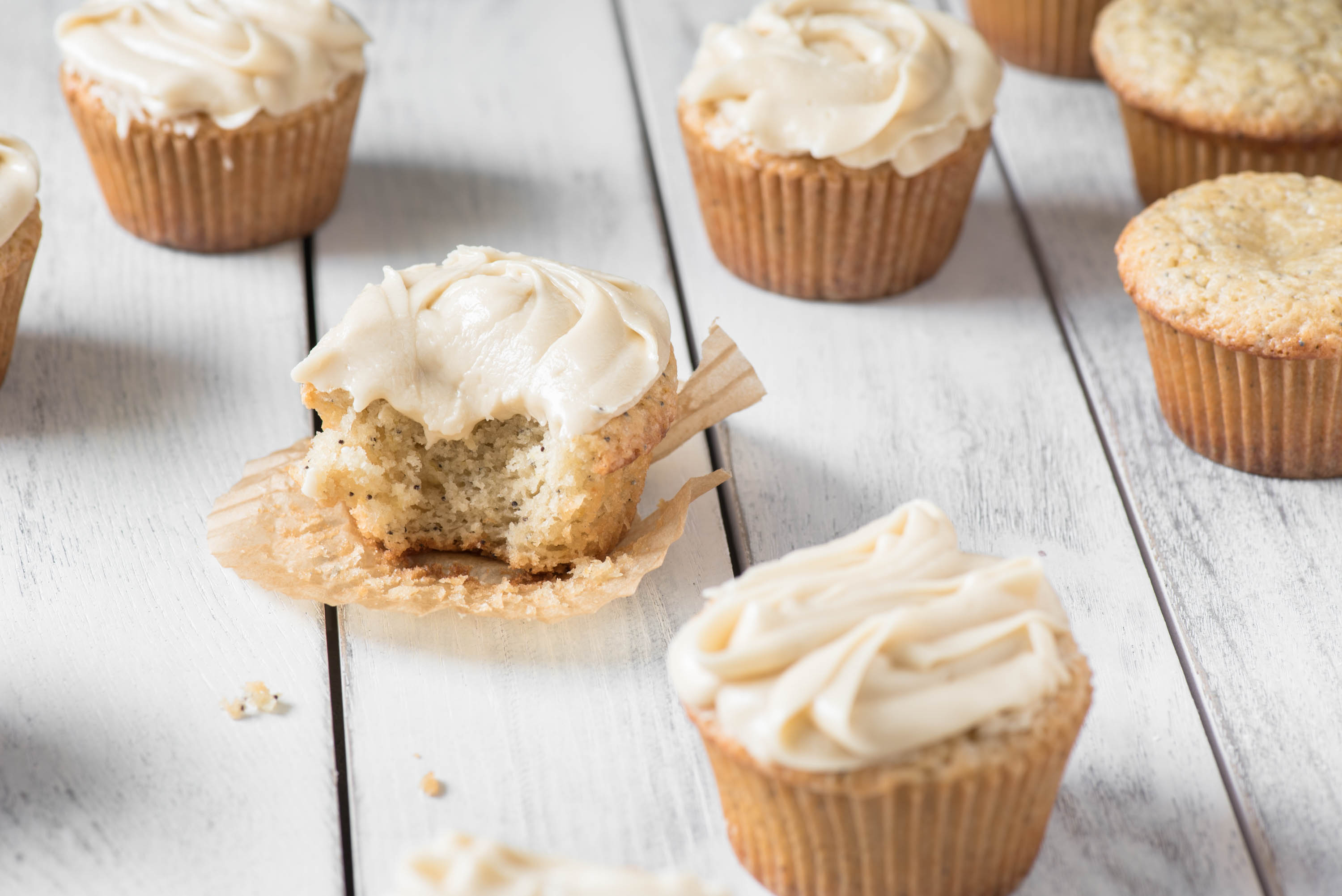 iced cupcake with a bite taken out of it