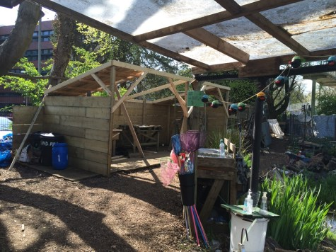 covered area with pond dipping equipment, new woodshed construction to the rear
