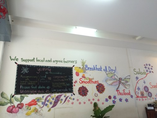 Cheerful wall painting in a vegetarian cafe, Chiang Mai