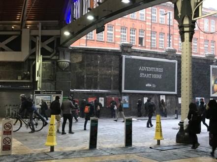 Snow blowing into Paddington Station