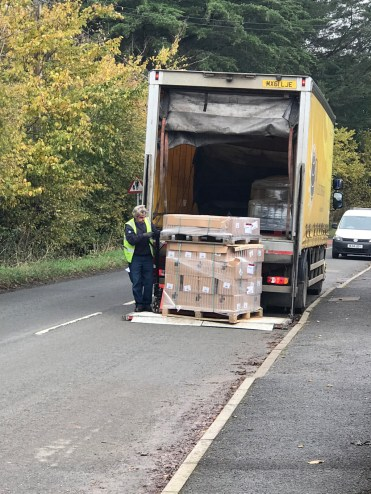 The lorry arrived with the huge pallet of books