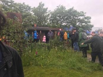 visitors enjoying the garden (raining again!)